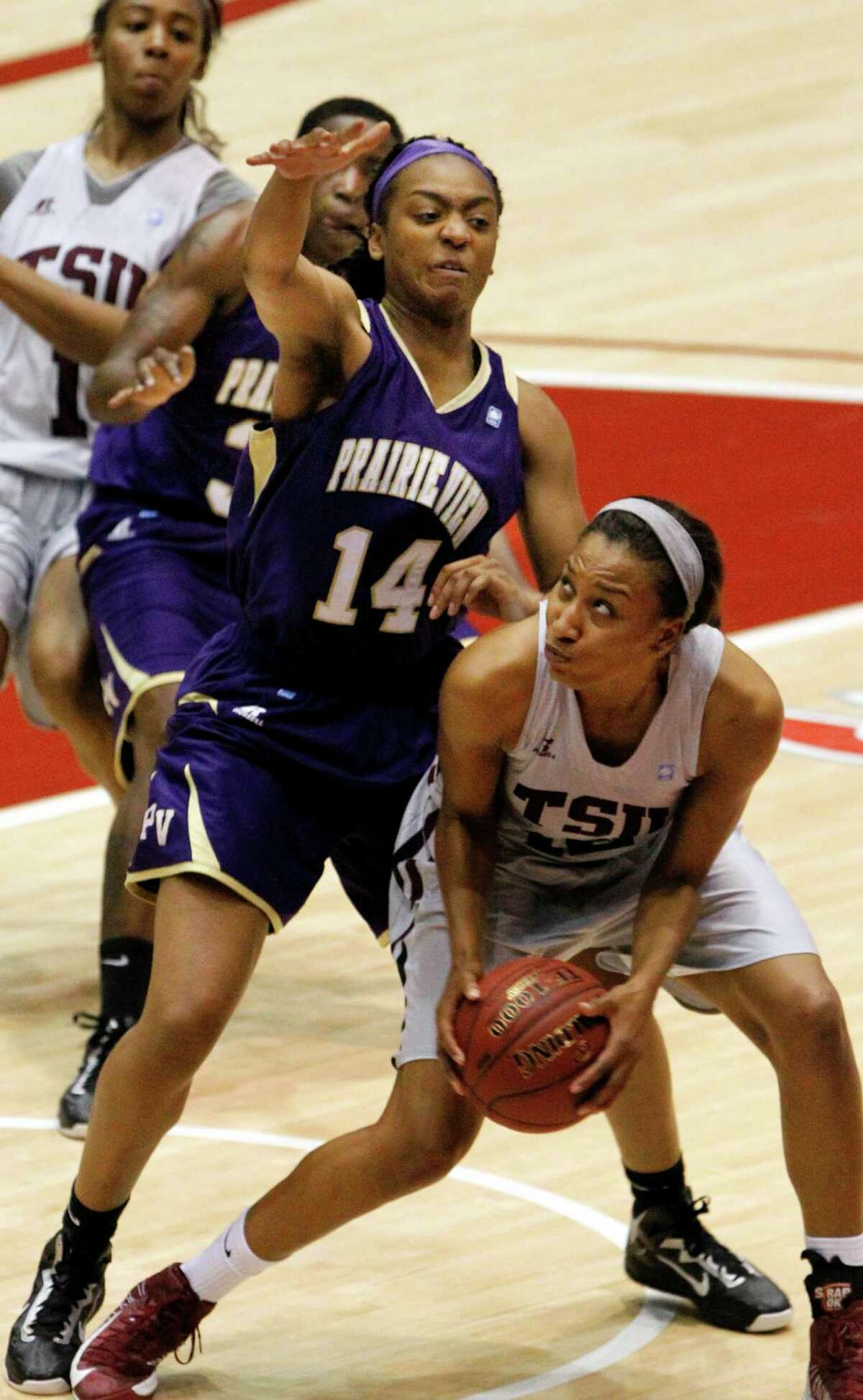 TSU forward Morgan Simmons, right, searches for help against Prairie View's Chelsea Azore.