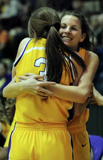 Troy's Meg Driscoll, right, hugs Mary Pattison at the end of their Class A semifinal state basketbal