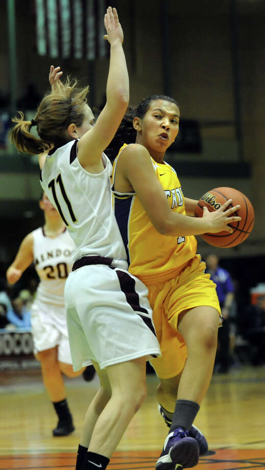 Troy's Kiana Patterson, right, drives past Pittsford Mendon's Courtney Case during their Class A semifinal state basketball game on Friday, March 15, 2013, at Hudson Valley Community College in Troy, N.Y. (Cindy Schultz / Times Union) Photo: Cindy Schultz / 10021543A