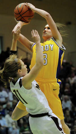 Troy's Mary Pattison, right, goes to the hoop as Pittsford Mendon's Courtney Case defends during their Class A semifinal state basketball game on Friday, March 15, 2013, at Hudson Valley Community College in Troy, N.Y. (Cindy Schultz / Times Union) Photo: Cindy Schultz / 10021543A