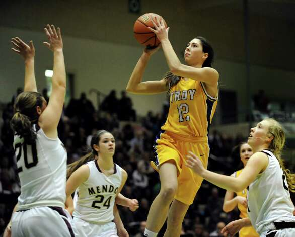 Troy's Courtney Avery, center, goes to the hoop during their Class A semifinal state basketball game against Pittsford Mendon on Friday, March 15, 2013, at Hudson Valley Community College in Troy, N.Y. (Cindy Schultz / Times Union) Photo: Cindy Schultz / 10021543A