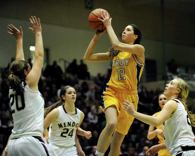 Troy's Courtney Avery, center, goes to the hoop during their Class A semifinal state basketball game