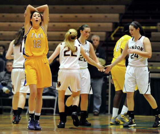 Troy's Courtney Avery, left, reacts when she's called on a foul during their Class A semifinal state basketball game against Pittsford Mendon on Friday, March 15, 2013, at Hudson Valley Community College in Troy, N.Y. (Cindy Schultz / Times Union) Photo: Cindy Schultz / 10021543A