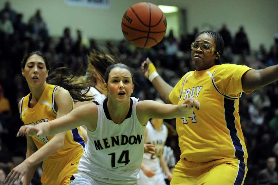 Troy's Courtney Avery, left, and Cheyenne Williams, right, go against Pittsford Mendon's Kristin Powers for a loose ball during their Class A semifinal state basketball game on Friday, March 15, 2013, at Hudson Valley Community College in Troy, N.Y. (Cindy Schultz / Times Union) Photo: Cindy Schultz / 10021543A