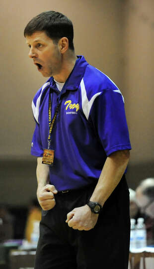 Troy's coach Paul Bearup instructs his team during their Class A semifinal state basketball game aga