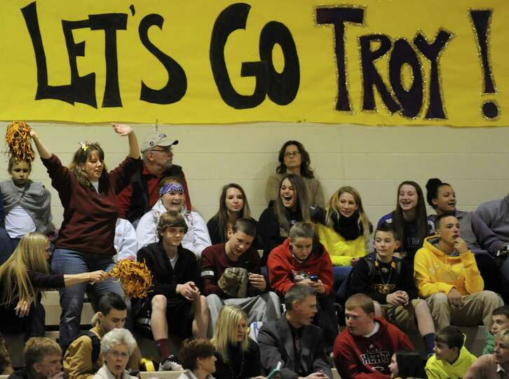 Troy's fans support their team during their Class A semifinal state basketball game against Pittsfor