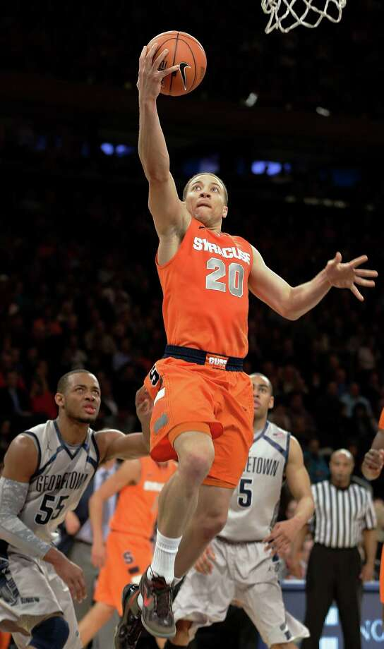 Brandon Triche (20) came up big late to send Syracuse to the Big East tournament final. Photo: Frank Franklin II, STF / AP