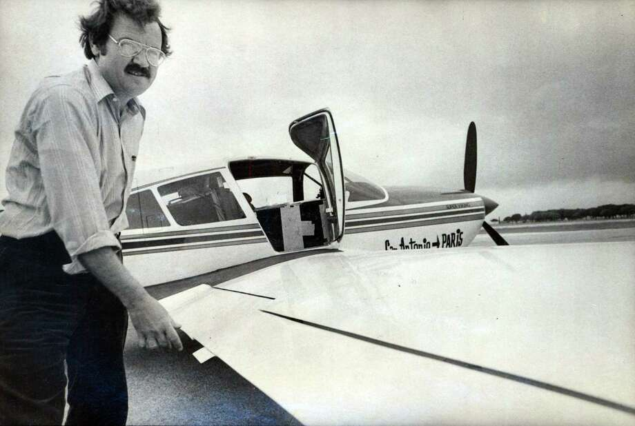 "Phil Hardberger checks the wing of his plane, called the ""Spirit of San Antonio,"" prior to his flight in 1977. Photo: San Antonio Express-News"