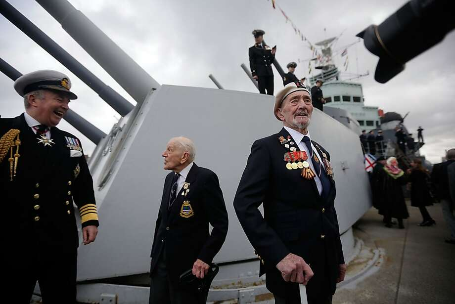 Navy officers and veterans relax on the deck of the HMS Belfast during the 75th anniversary celebrations of the iconic warship's launch on March 15, 2013 in London, England. Launched in 1938 and moored in central London since 1971, the ship played in important part in sinking the German battleship Scharnhorst in World War II.  (Photo by Matthew Lloyd/Getty Images) Photo: Matthew Lloyd, Getty Images