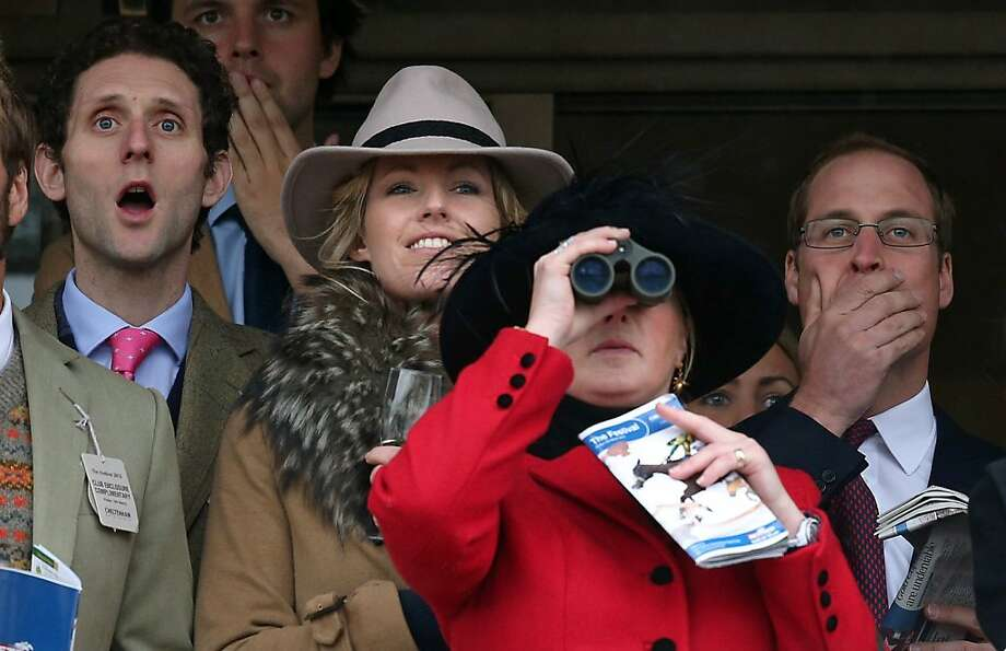 Prince William, Duke of Cambridge (R) watches the races on with other racegoers on Gold Cup Day at Cheltenham Racecourse on the fourth and final day of the Cheltenham Festival 2013 on March 15, 2013 in Cheltenham, England. Approximately 200,000 racing enthusiasts are expected at the four-day festival, which ends today and is seen as many as the highlight of the jump racing calendar on March 12, 2013 in Cheltenham, England.  (Photo by Matt Cardy/Getty Images) Photo: Matt Cardy, Getty Images