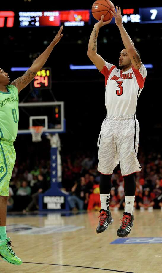 Louisville's Peyton Siva (3) shoots over Notre Dame's Eric Atkins (0) during the first half of an NCAA college basketball game at the Big East Conference tournament Friday, March 15, 2013, in New York. (AP Photo/Frank Franklin II) Photo: Frank Franklin II