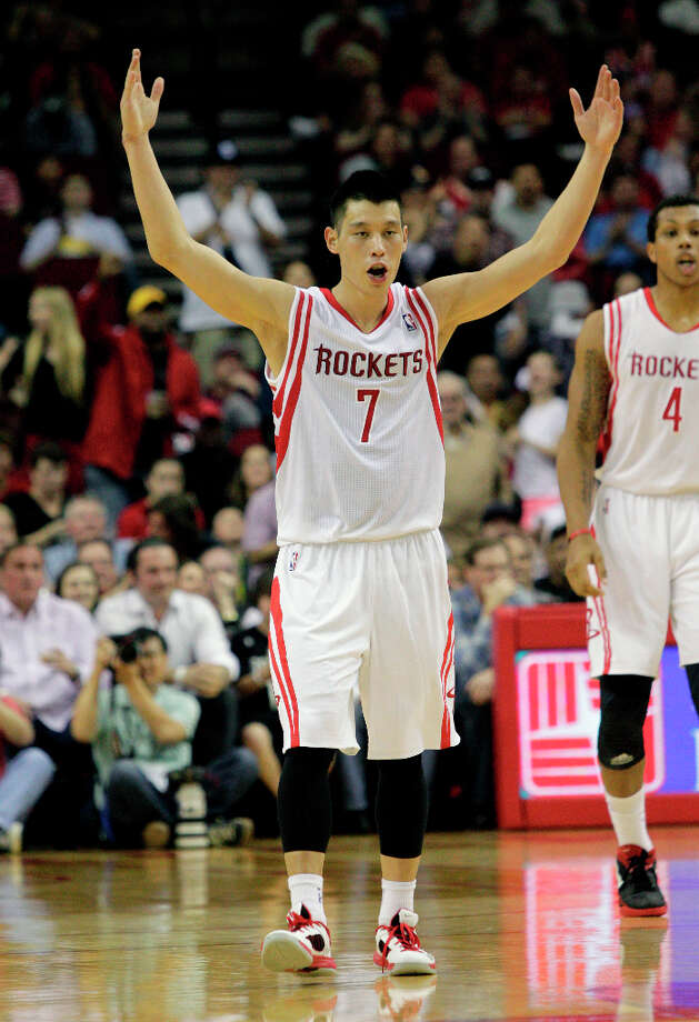 Rockets point guard Jeremy Lin pumps up the crowd after making a 3-pointer. Photo: Bob Levey / ©2013 Bob Levey