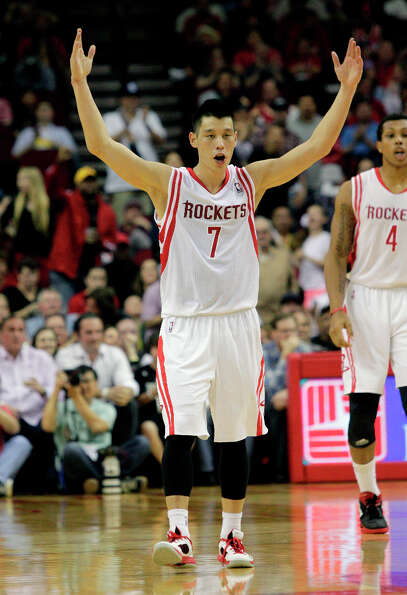 Rockets point guard Jeremy Lin pumps up the crowd after making a 3-pointer.