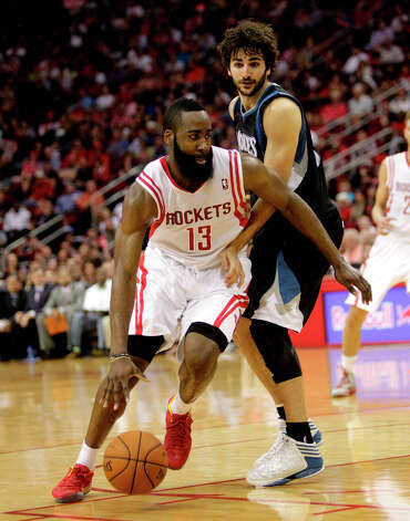 Rockets guard James Harden dribbles around Ricky Rubio of the Timberwolves. Photo: Bob Levey / ©2013 Bob Levey