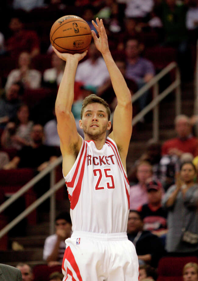 Rockets forward Chandler Parsons attempts a 3-pointer against the Timberwolves. Photo: Bob Levey / ©2013 Bob Levey