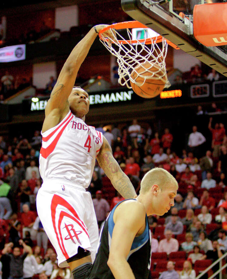 Rockets forward Greg Smith dunks on Greg Stiemsma of the Timberwolves. Photo: Bob Levey / ©2013 Bob Levey