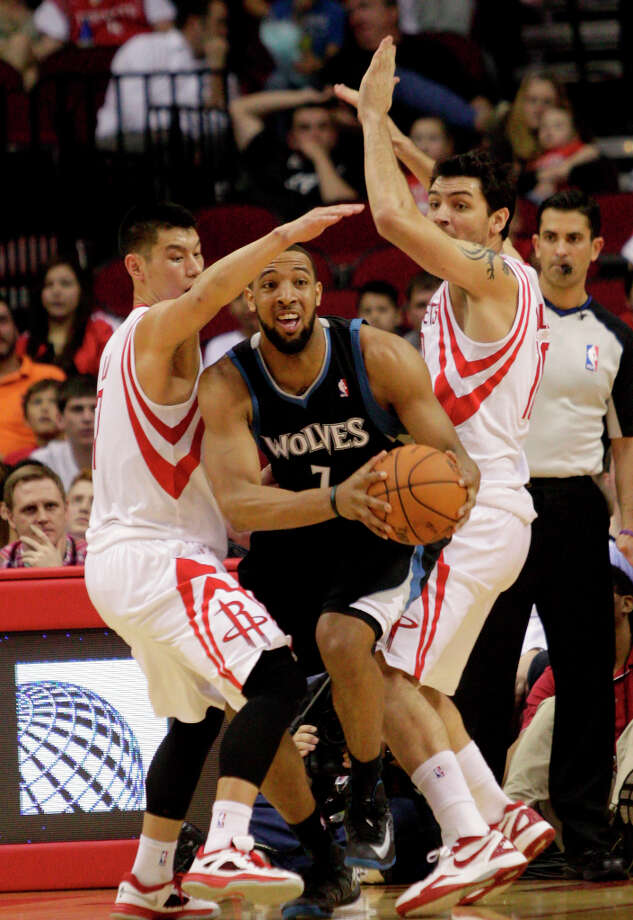 Timberwolves forward Derrick Williams is trapped by Jeremy Lin and Carlos Delfino of the Rockets. Photo: Bob Levey / ©2013 Bob Levey