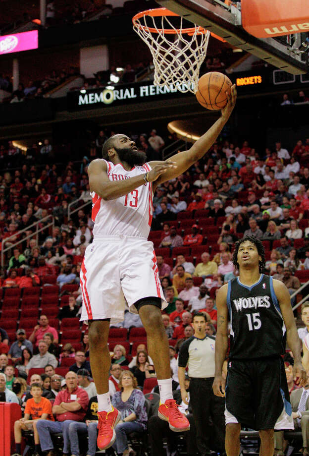 Rockets shooting guard James Harden glides to the basket for two points. Photo: Bob Levey / ©2013 Bob Levey