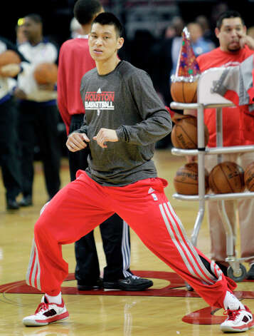 Jeremy Lin of the Rockets warms up before playing the Timberwolves. Photo: Bob Levey / ©2013 Bob Levey