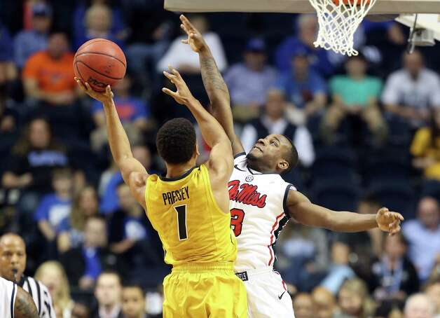 NASHVILLE, TN - MARCH 15:  Derrick Millinghaus #3 of the Ole Miss Rebels defendes the shot of Phil Pressey #1 of the Missouri Tigers during the quarterfinals of the SEC Baketball Tournament at Bridgestone Arena on March 15, 2013 in Nashville, Tennessee.  (Photo by Andy Lyons/Getty Images) Photo: Andy Lyons