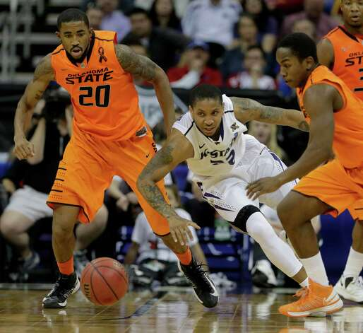 Kansas State guard Rodney McGruder, center, chases a loose ball with Oklahoma State forward Michael Cobbins (20) and guard Kirby Gardner (1) during the first half an NCAA college basketball game in the Big 12 men's tournament on Friday, March 15, 2013, in Kansas City, Mo. (AP Photo/Charlie Riedel) Photo: Charlie Riedel, Associated Press / AP