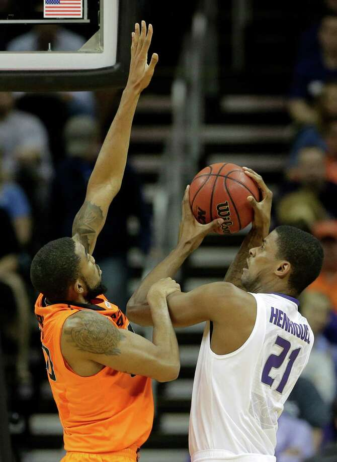 Kansas State forward Jordan Henriquez (21) shoots under pressure from Oklahoma State forward Michael Cobbins during the first half an NCAA college basketball game in the Big 12 men's tournament on Friday, March 15, 2013, in Kansas City, Mo. (AP Photo/Charlie Riedel) Photo: Charlie Riedel, Associated Press / AP