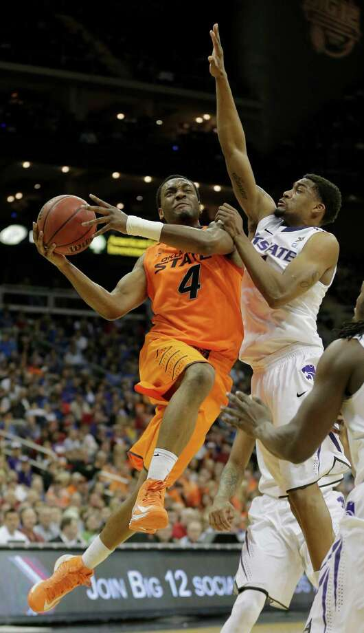Oklahoma State: Guard/forward Brian Williams (4) gets past Kansas State guard Shane Southwell (1) to shoot during the first half an NCAA college basketball game in the Big 12 men's tournament on Friday, March 15, 2013, in Kansas City, Mo. (AP Photo/Charlie Riedel) Photo: Charlie Riedel, Associated Press / AP