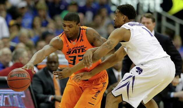 Oklahoma State guard Marcus Smart (33) tries to get around Kansas State guard Shane Southwell (1) during the first half an NCAA college basketball game in the Big 12 men's tournament on Friday, March 15, 2013, in Kansas City, Mo. (AP Photo/Charlie Riedel) Photo: Charlie Riedel, Associated Press / AP