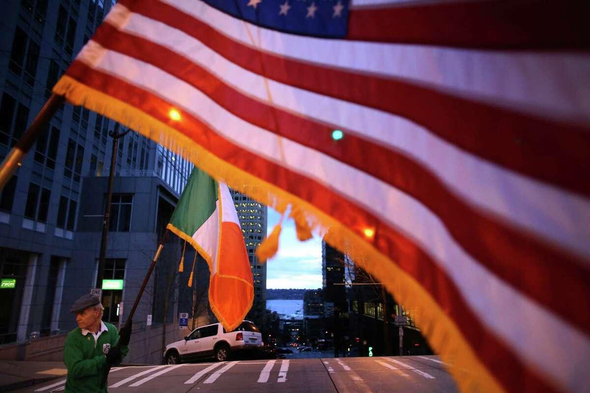 Tom O'Callahan carries an Irish flag.