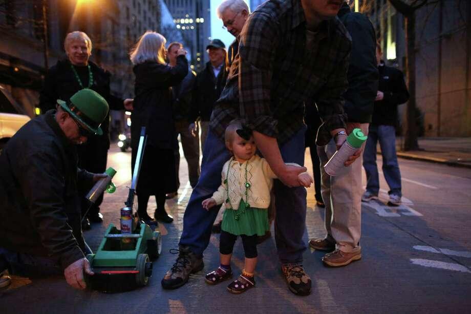 Ava Terzieff, 1 1/2, tries to grab a can of paint. Photo: JOSHUA TRUJILLO / SEATTLEPI.COM