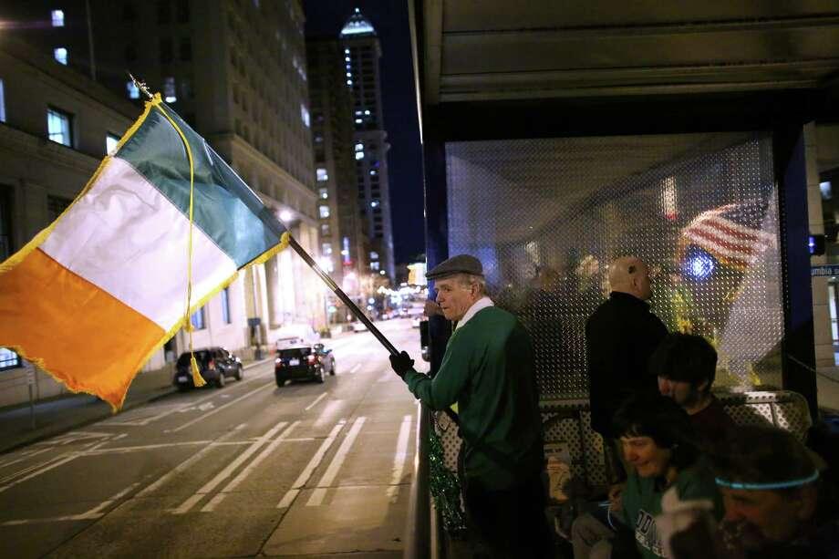 Tom O'Callahan carries an Irish flag. Photo: JOSHUA TRUJILLO / SEATTLEPI.COM