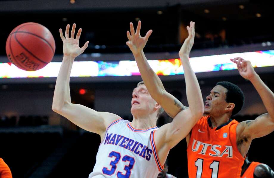 UT Arlington's Karol Gruszecki (33) and UTSA's Michael Hale III (11) reach out for a rebound during the first half of a Western Athletic Conference tournament NCAA college basketball game, Friday, March 15, 2013 in Las Vegas. Photo: David Becker, Associated Press / FR170737 AP