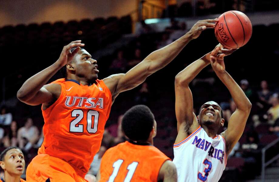 UTSA's Edrico McGregor (20) blocks a shot by UT Arlington's Jamel Outler (3) during the first half of a Western Athletic Conference tournament NCAA college basketball game, Friday, March 15, 2013 in Las Vegas. Photo: David Becker, Associated Press / FR170737 AP