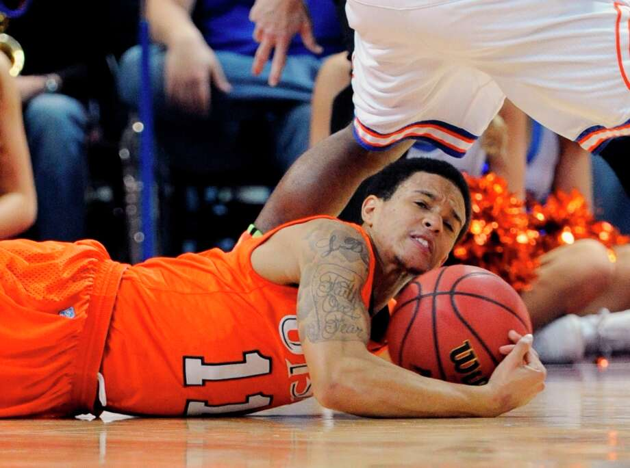 UTSA's Michael Hale III (11) grabs a loose ball during the first half of a Western Athletic Conference tournament NCAA college basketball game against UT Arlington, Friday, March 15, 2013 in Las Vegas. Photo: David Becker, Associated Press / FR170737 AP