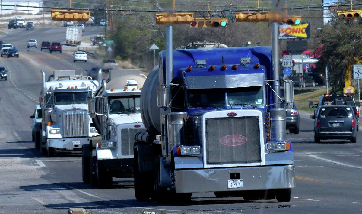 Truck traffic related to the Eagle Ford Shale energy boom travels through Kenedy, Texas, on Friday, March 15, 2013.