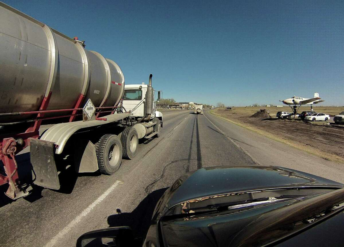 Truck traffic related to the Eagle Ford Shale energy boom travels on Highway 181 near Kenedy, Texas, on Friday, March 15, 2013.