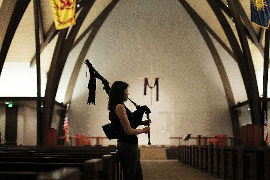 Isabel Stenzel plays her bagpipes inside St. Andrew's Episcopal Church in Saratoga, Calif. as she rehearses with the Stewart Tartan Pipes and Drums on Tuesday, March 12. Stenzel had to have a double lung-transplant due to her Cystic Fibrosis and now she plays bagpipes and exercises regularly. (Photo: James Tensuan, The Chronicle)
