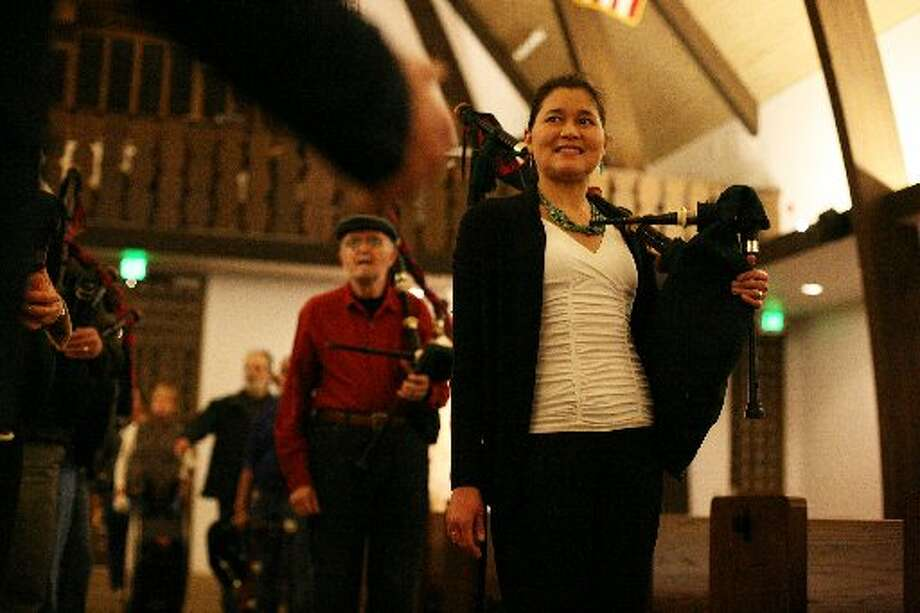 Isabel Stenzel listens in as she wraps up a practice with the Stewart Tartan Pipes and Drums at St. Andrew's Episcopal Church in Saratoga, Calif. on Tuesday, March 5. Stenzel had to have a double lung-transplant due to her Cystic Fibrosis and will be playing bagpipes and marching in the St. Patrick's Day Parade.