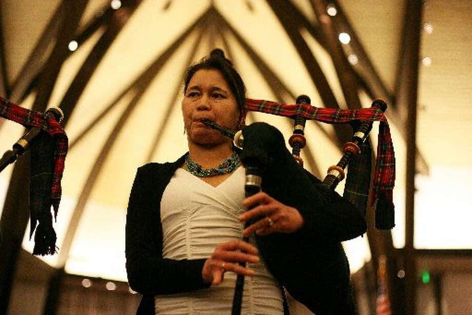 Isabel Stenzel plays her bagpipes inside St. Andrew's Episcopal Church in Saratoga, Calif. as she rehearses with the Stewart Tartan Pipes and Drums on Tuesday, March 5. Stenzel had to have a double lung-transplant due to her Cystic Fibrosis and now she plays bagpipes and exercises regularly.