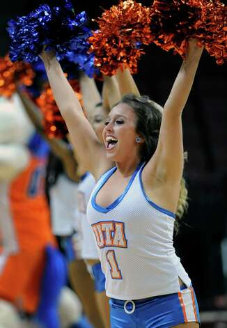 UT Arlington cheerleaders perform in support of their team during the first half of a Western Athletic Conference tournament NCAA college basketball game against UTSA, Friday, March 15, 2013 in Las Vegas. UT Arlington won 69-53. (AP Photo/David Becker) Photo: David Becker, Associated Press / FR170737 AP