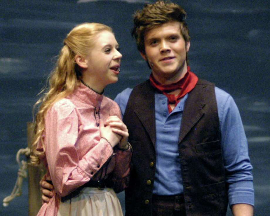 """Ashley Billings as Julie Jordan and Ben Bayers as Billy Bigelow perform in New Milford's High School's all-school musical production of Rodgers & Hammerstein's """"Carousel,"""" March 2013 Photo: Norm Cummings"""