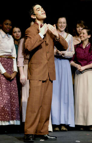 "John Vazquez as Enoch Snow in New Milford's High School's all-school musical production of Rodgers & Hammerstein's ""Carousel,"" March 2013 Photo: Norm Cummings"