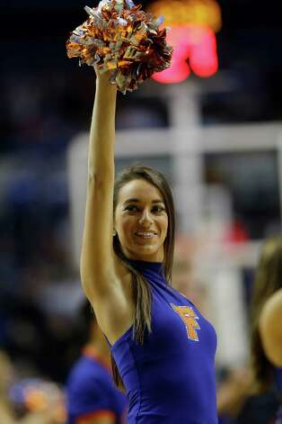 Florida cheerleaders perform during the second half of an NCAA college basketball game against  LSU at the Southeastern Conference tournament, Friday, March 15, 2013, in Nashville, Tenn. (AP Photo/Dave Martin) Photo: Dave Martin, Associated Press / AP