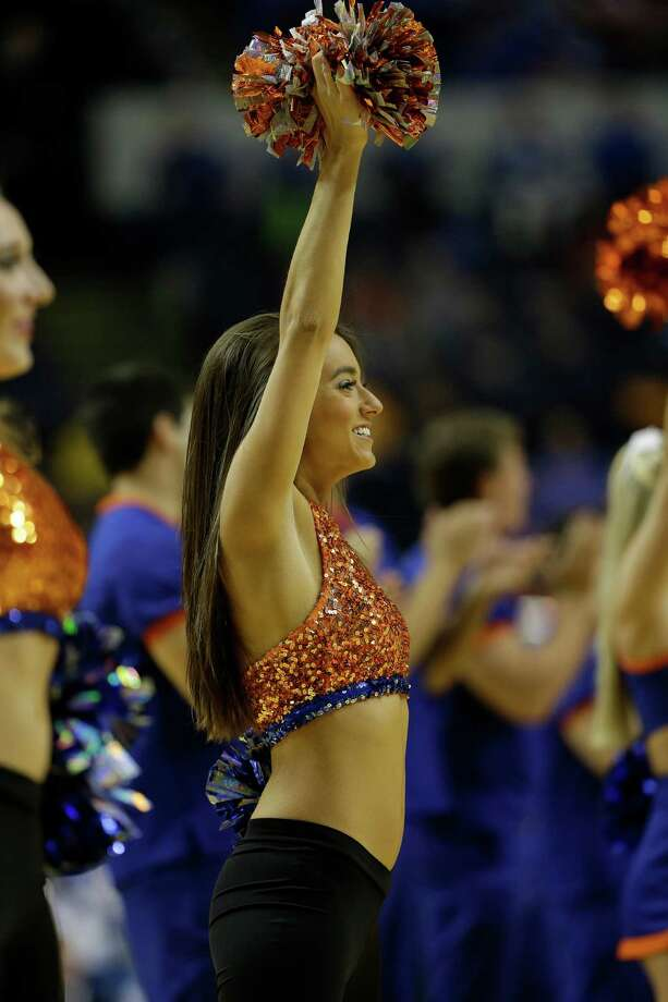 Florida  cheerleaders perform during the first half of an NCAA college basketball game against the LSU  at the Southeastern Conference tournament, Friday, March 15, 2013, in Nashville, Tenn. (AP Photo/Dave Martin) Photo: Dave Martin, Associated Press / AP