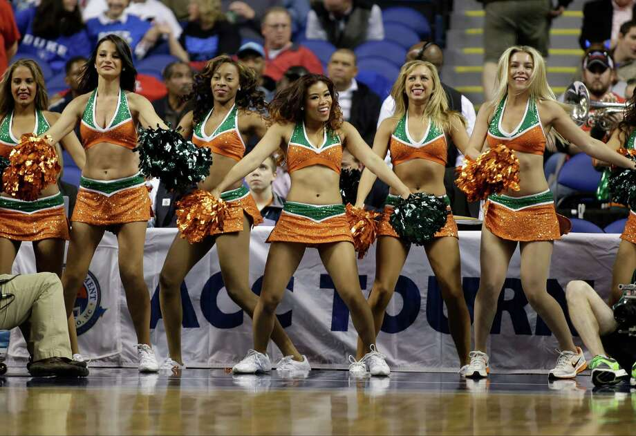 Miami cheerleaders perform during the first half of an NCAA college basketball game against Boston College at the Atlantic Coast Conference tournament in Greensboro, N.C., Friday, March 15, 2013. (AP Photo/Bob Leverone) Photo: Bob Leverone, Associated Press / FR170480 AP