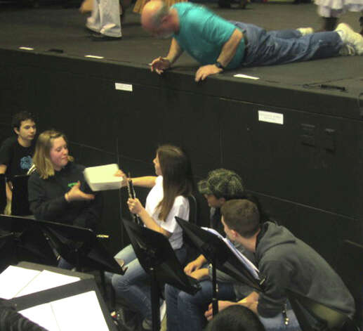"Forever young NMHS all-school musical play director Bob Keck, top, consults with pit orchestra director David Syzdek and his musicians during rehearsal for New Milford's High School's all-school musical production of Rodgers & Hammerstein's ""Carousel,"" March 2013 Photo: Norm Cummings"