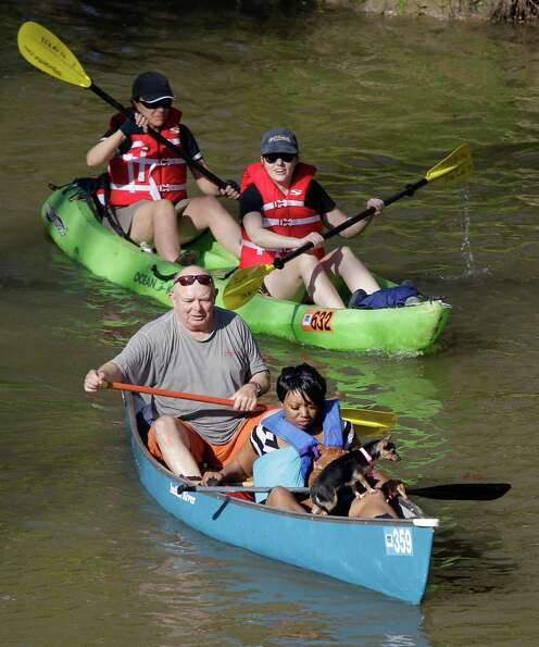 People paddle along during the Buffalo Bayou Regatta  Saturday, March 16, 2013 in Houston. At least