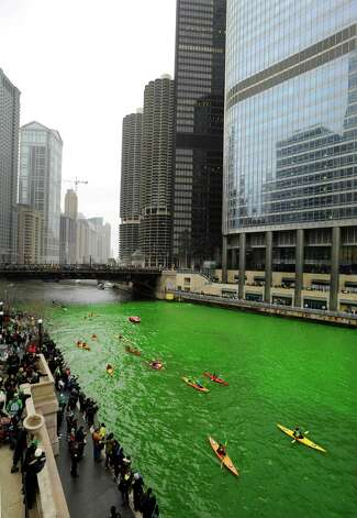 The Chicago River is dyed green right before the start of the St. Patrick's Day parade in Chicago, Saturday, March, 16, 2013.  With the holiday itself falling on a Sunday, many celebrations were scheduled instead for Saturday because of religious observances. Photo: Paul Beaty