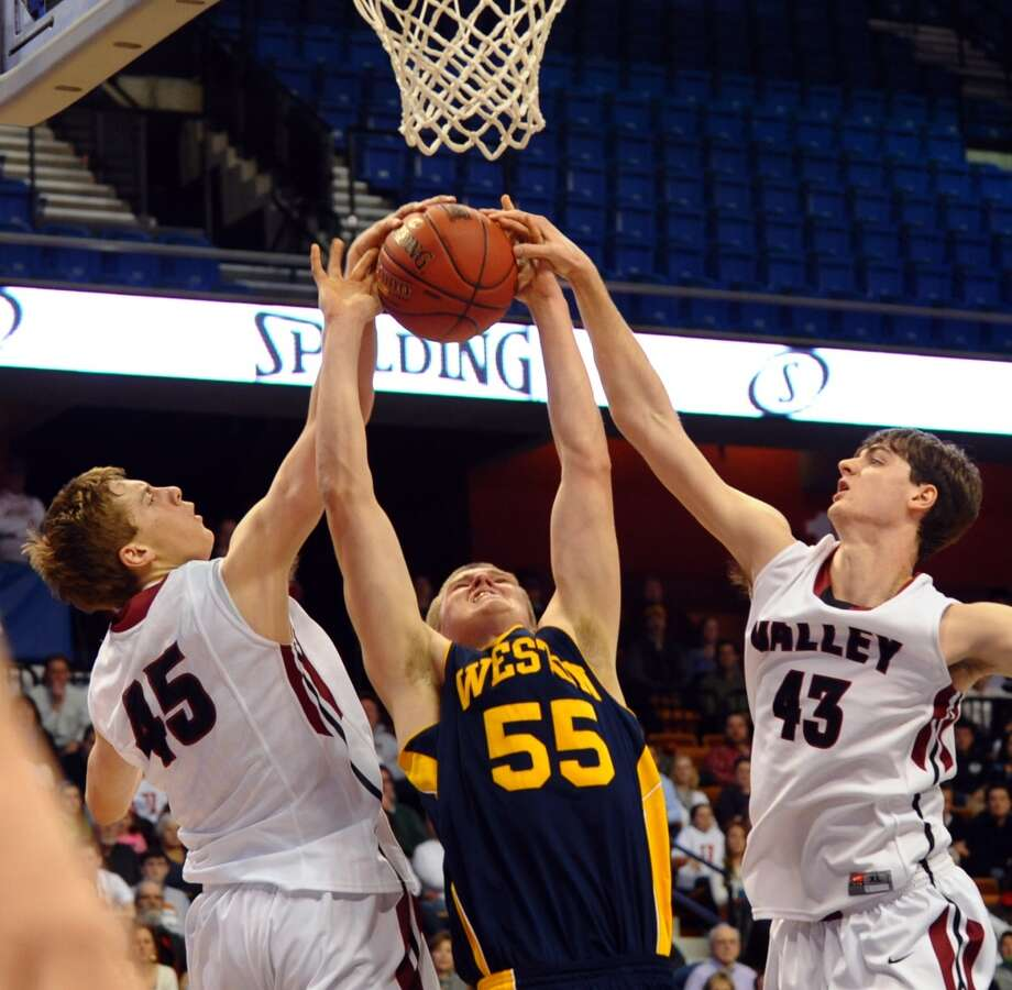 Weston's #55 Pascal Arvoy gets stopped by Valley Regional's #45 Chris Polo, left, and #43 Chris Connor, during Class M boys basketball final action at the Mohegan Sun Arena in Uncasville, Conn. on Friday March 15, 2013.