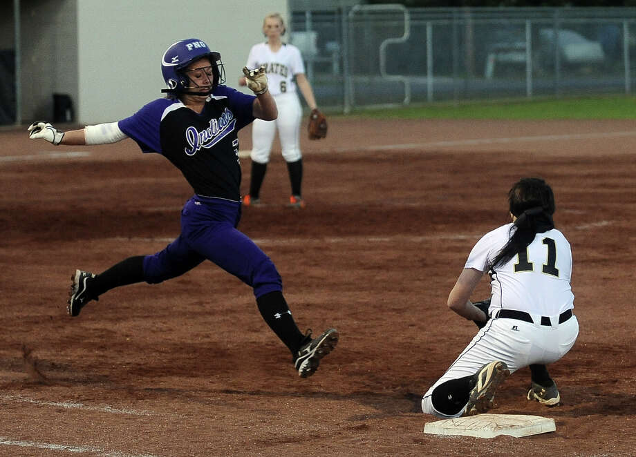 PN-G player Hannah Hernandez, #3, is thrown out at first in the top of the third inning of the Vidor High School District 20-4A girls softball game against Port Neches-Groves High School on Friday, March 15, 2013, in Vidor. Photo taken: Randy Edwards/The Enterprise Photo: Randy Edwards